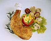 Chicken leg with stuffed tomato, salad and mushrooms