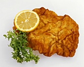 Wiener Schnitzel with lemon slice and lettuce leaf