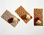 Three crispbreads with butter and jam