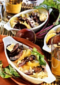 Beetroot and feta gratin with potatoes in three baking dishes