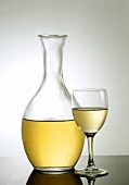 White wine in glass and carafe