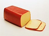 A block of Edam with two slices cut off