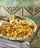 Pasta with cabbage, sprinkled with paprika, in deep plate