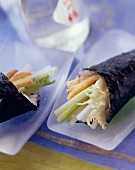 Sushi roll with vegetables in white dish