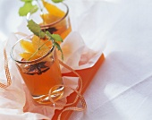 Orange punch jelly with mint leaves in glasses