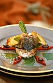 Sea bass fillet with saffron, pepper diamonds & green sauce