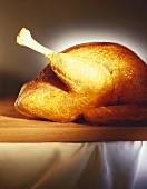 Roast turkey on wooden board