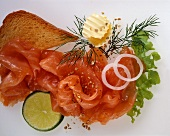 Salmon with toast, butter and lime slice