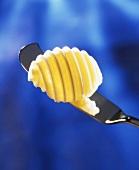 Butter curl on a butter knife