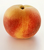 A peach on white background