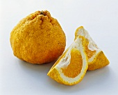 Whole ugli fruit and two segments