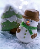 Snowman and fir tree biscuits, decorated with icing