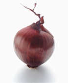 A red onion on white background