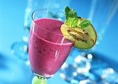 Blueberry drink with kiwi slice and fresh mint
