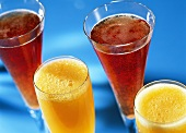 Various cocktails with champagne and fruit juice