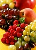 Various types of fruit (grapes, raspberries, peach)