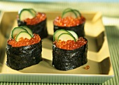 Gunkan maki with trout caviare on yellow platter