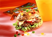 Confetti burger with pieces of pepper in front of napkins
