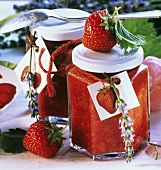 Strawberry preserve in jam jars decorated with lavender