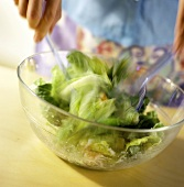 Tossing Caesar Salad