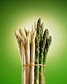 A bundle of white and green asparagus: green backdrop