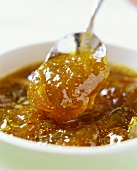 Fig jam on spoon and in bowl