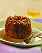 Small chocolate cake with nuts and syrup