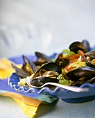 Mussels with tomatoes on a blue plate