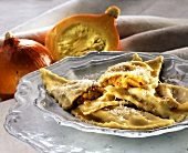 Pumpkin ravioli with mustard fruits and grated cheese