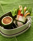 Vegetables in rice paper parcel with peanut dip