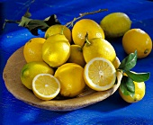Lemons, two halved, in a bowl