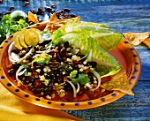 Kidney bean salad with onions, limes and taco chips