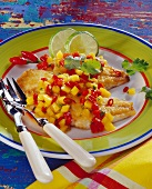 Red snapper with mango salsa and lime slices