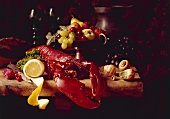 Still life with boiled lobster, fresh fruit and snails