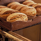 Loaves of bread on a wooden tray