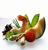 Still life with melon, asparagus, mangetouts and scampi