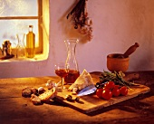 Italian still life with parmesan, tomatoes, red wine etc