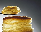 Puff pastry with a piece on a fork