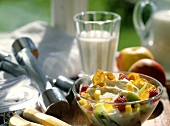 Quark muesli with cornflakes and fruit; Milk; Sports gear