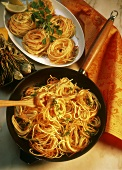 Pasta nests with carrots in pan and on platter