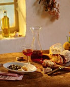 Italian still life with bread, olives, cheese, wine