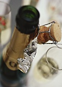 Opened champagne bottle with corks