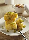 Coconut rice cake with chopped pistachios