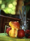 Pears and apples in a glass bowl on table