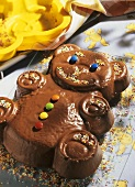 Chocolate cake in the shape of a bear with sugar sprinkles