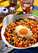 Egg in nest: fried egg on vegetables