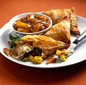 Filo pastry parcels with vegetable filling on plate