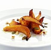 Fried pumpkin slices with pumpkin seeds