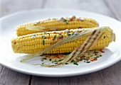 Grilled corn cobs with spicy butter sauce