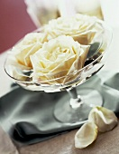 White roses in crystal bowl